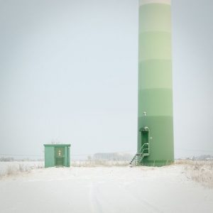 wind turbine towers with vertical colored painting on it