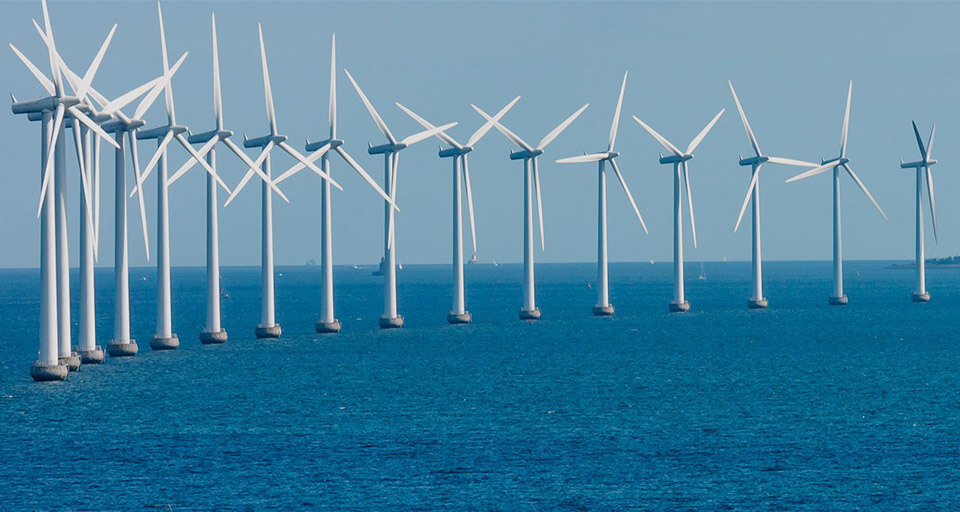 a picture of offshore wind turbine towers